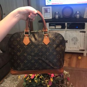Louis Vuitton Alma good used PM